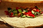 stock photo of shawarma  - Traditional shawarma with chicken and vegetables in unwrapped condition - JPG