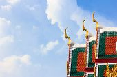 stock photo of buddhist  - Delicate Thai art at roof top of Buddhist temple in Bangkok Thailand - JPG