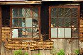 picture of windows doors  - Industrial building broked down doors and windows - JPG