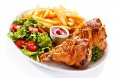 picture of thighs  - Grilled turkey thighs with chips and vegetables  - JPG