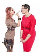 picture of makeup artist  - Professional makeup artist making makeup to a model isolated on white background - JPG