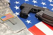 pic of handgun  - Handgun over US flag  - JPG
