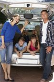 stock photo of car carrier  - Family Sitting In Trunk Of Car - JPG