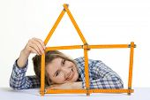 picture of meter stick  - young woman forms meter stick into a house shape - JPG