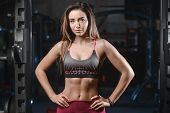Beautiful Fitness Woman Trains In The Gym. poster