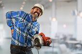 Senior Hispanic worker suffering  back injury inside building poster