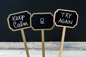 Keep Calm And Try Again Message Written With Chalk On Mini Blackboard Labels poster