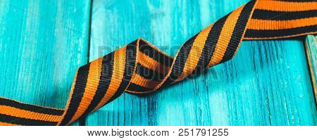 George Ribbon In Hands Symbol