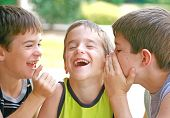 foto of hysterics  - Three Boys Telling Secrets and Laughing Hysterically - JPG