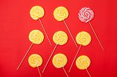 Sweet Caramel Candy On A Red Background. Bright Lollipops. Yellow And Pink Sweets From The Confectio poster