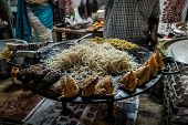 Indian Street Food Making Of Vegetarian Noodles. Man Is Frying Noodles On The Street. Goa India. Var poster