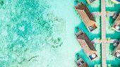 Aerial Top View Water Villa At Maldives Island, Beautiful Tropical Maldives Resort Hotel. poster