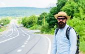 Man At Edge Of Highway Looking For Transport. On The Road. Hitchhiking Means Transportation That Gai poster