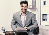 Writer Or Businessman Wearing Grey Suit. Young Author Or Editor Writes Story On Old Typewriter On Wi poster