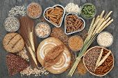 Food high in dietary fibre with whole grain bread and seeded rolls, whole wheat pasta, seeds, cereal poster