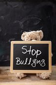 Teddy Bear Behind A Blackboard, Stop Bullying Text On The Blackboard poster
