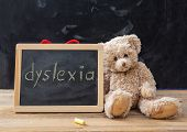 Teddy Bear And A Blackboard. Dyslexia Text Drawing On The Blackboard poster