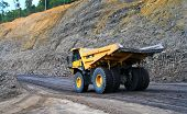 picture of earth-mover  - a panning shot a dump truck working on coal site - JPG