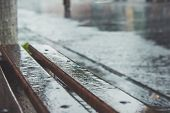 Rain, City, Wet Bench And The Concept Of Rainy Weather In The City poster