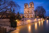 Notre Dame De Paris Catheral At Dusk With The Overflowing Seine River, 4th Arrondissement, Paris, Fr poster