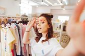 Blogger And Selfie. Stylish Beautiful Fashion Blogger Making Selfie While Standing In Shopping Mall poster