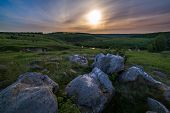 Night Glacial Stones In Field Landscape Under Moonlight Halo poster
