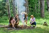 Company Friends Picnic Or Barbecue Roasting Food Near Bonfire. Hike Barbecue. Best Friends Spend Lei poster