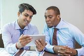 Cheerful Business Colleagues Testing New App In Conference Room. Smiling Indian And Afro American In poster