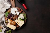 Wine, cheese, grape, bread and nuts. Top view with space for your text poster