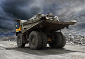 picture of iron ore  - Heavy mining truck driving along the opencast - JPG