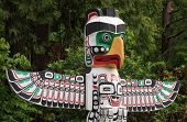 stock photo of indian totem pole  - A native totem pole in Vancouver BC Canada home of the 2010 Olympics - JPG