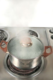 foto of boiling water  - steaming pot  of boiling water - JPG