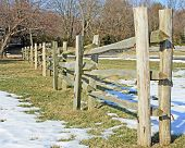 stock photo of split rail fence  - Split rail fence with double posts in winter. ** Note: Shallow depth of field - JPG