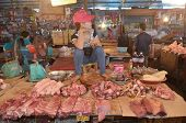 Woman sells raw meat