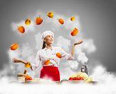 picture of juggler  - juggler female asian cook against color background - JPG