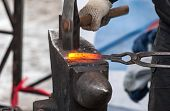pic of blacksmith shop  - Blacksmith forges iron in the forge close up - JPG