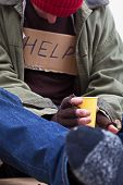 pic of begging  - Poor man begging for a help with tea cup - JPG