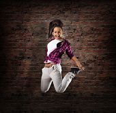 stock photo of rap-girl  - Young girl dancer in jump - JPG