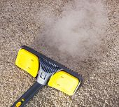 stock photo of dust mite  - Using dry steam cleaner to sanitize floor carpet - JPG
