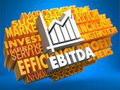 stock photo of amortization  - EBITDA with Growth Chart Icon on Yellow WordCloud on Blue Background - JPG