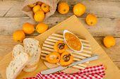 pic of loquat  - Fresh homemade loquat jam surrounded by ripe fruit - JPG