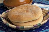 pic of tagine  - Moroccan bread and tagine on the table - JPG