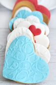 stock photo of sugar paste  - Shortbread cookies in the shape of heart decorated with sugar paste - JPG