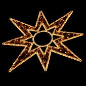 stock photo of weihnacht  - Illuminated Christmas Star Decoration on Black at a Christmas Market (Weihnachtsmarkt) in Germany