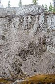 image of sedimentation  - Old limestone quarry with vertical layered sedimentation - JPG