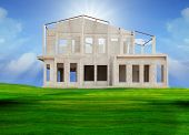 stock photo of land development  - frame knock down of house construction on beautiful green grass field use for real estate and land development business - JPG