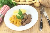 stock photo of rutabaga  - Venison goulash with turnip and cooked potatoes - JPG
