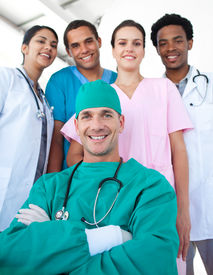 pic of health-care  - International medical team with a confident surgeon with folded arms in the foreground - JPG