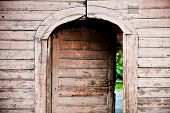 stock photo of front-entry  - Architecture detail with a very old wooden house front door