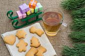 image of flogging  - Christmas theme with floggings sled biscuits and tea - JPG